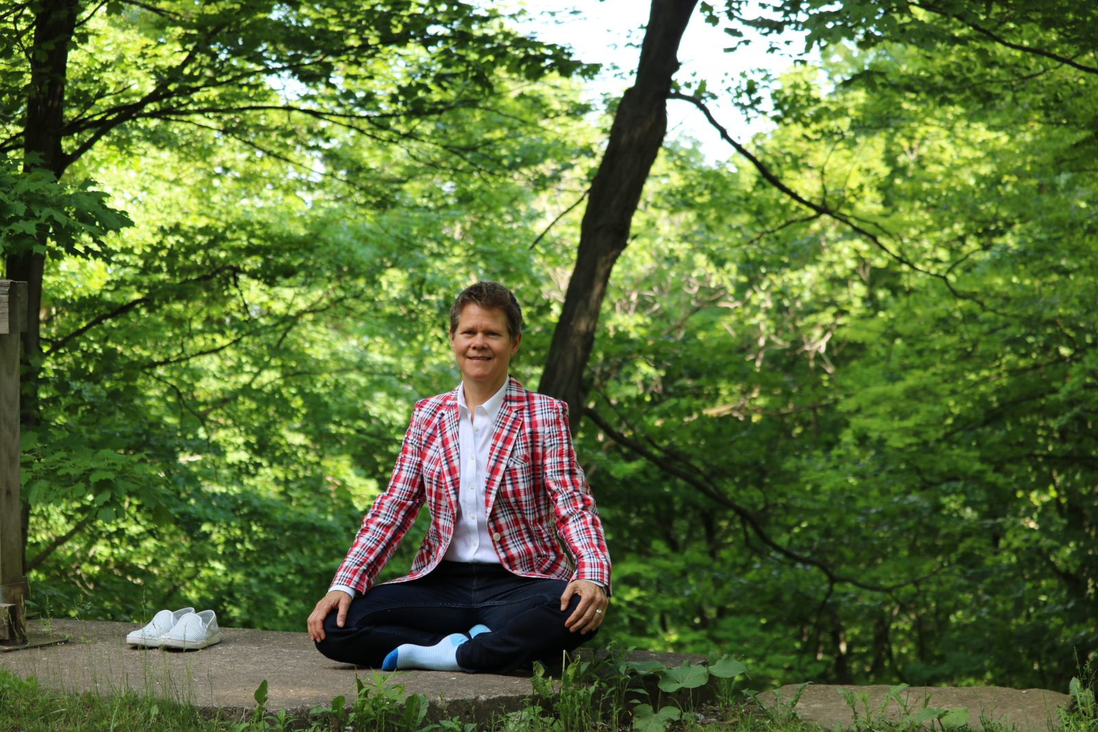 Paula Gardner meditates outside.
