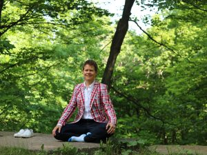Paula Gardner meditates outside.