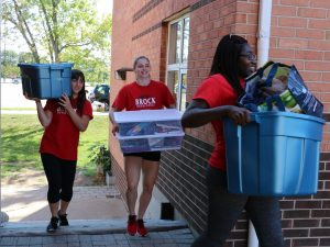 Brock University volunteers help out during Move In Day.