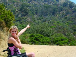 Christi Rougoor points to the Hollywood sign during her first trip to California.