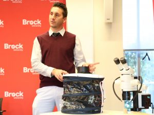 Alessio Gasparotto, Manager, Entomogen Inc., shows a mosquito trap that baits the bugs with human flesh.