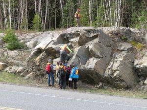 Students climbing rocks