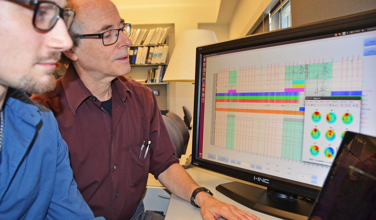 Sid Segalowitz looks over brainwave data