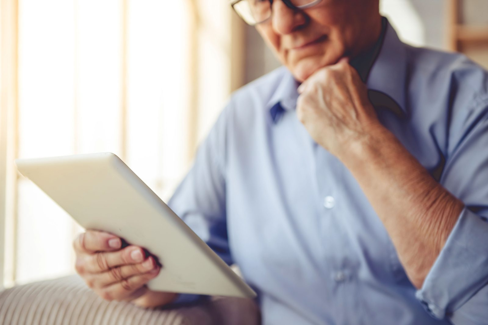 Senior with tablet