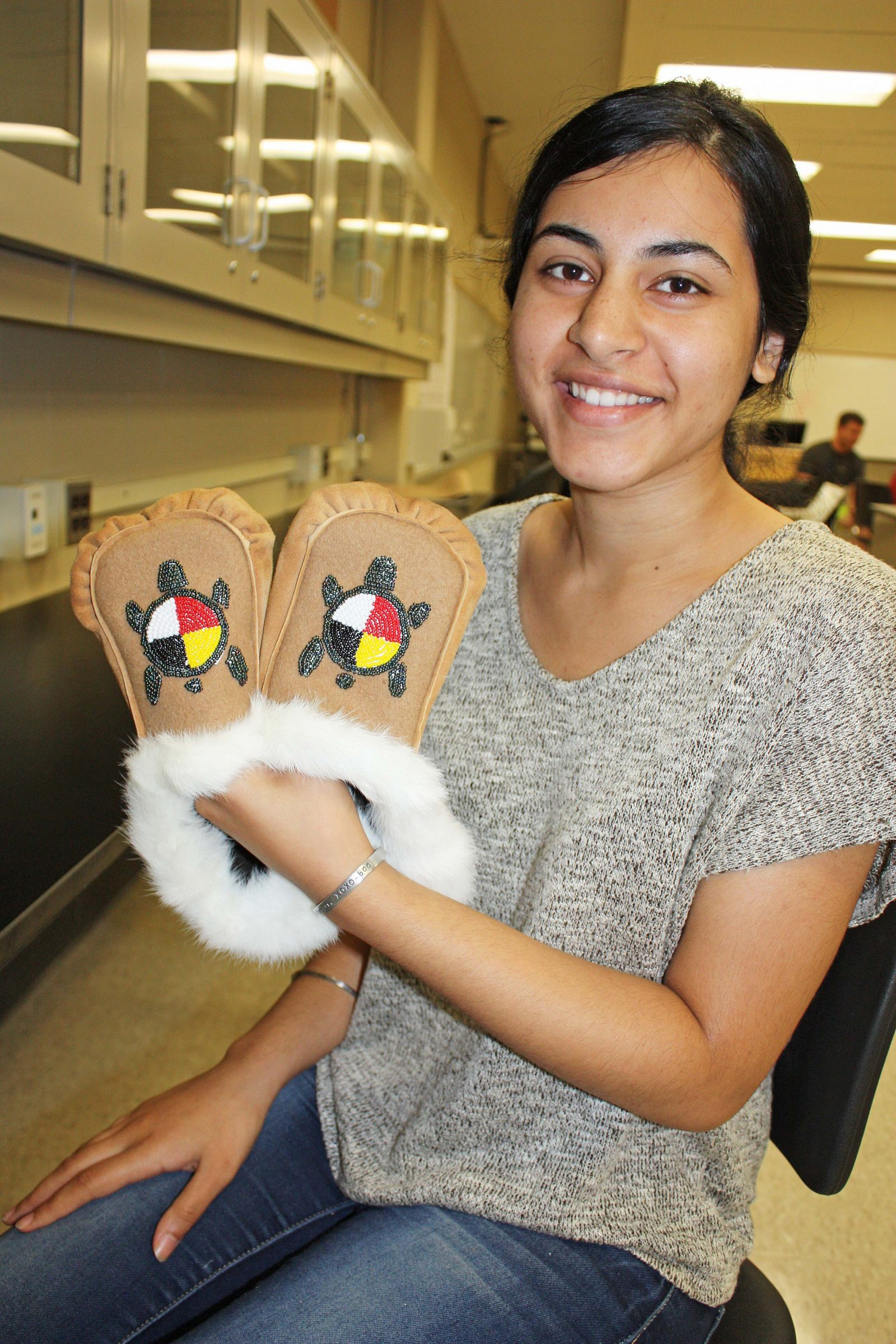 Student with moccasins