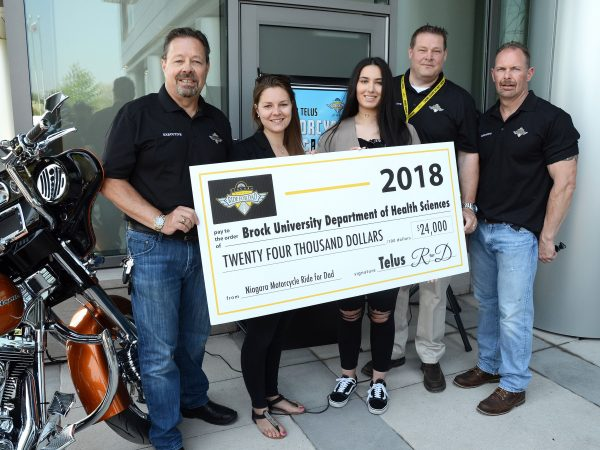 Ride for Dad cancer research cheque